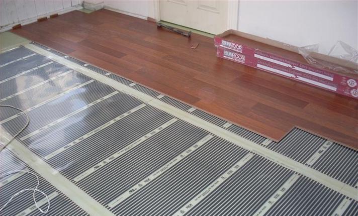 Покрытие на теплый пол: выбор плитки, ламината, линолеума