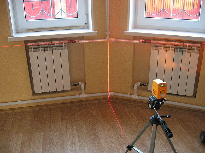 Радиаторы отопления в полу под окном