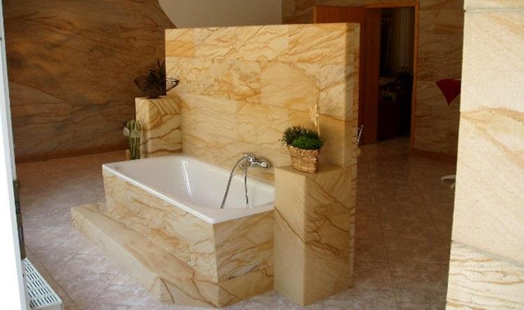 Гибкий камень в интерьере: фото, можно ли использовать в гостиной, ванной, на кухне и в облицовке фасадов
