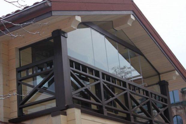 Безрамное остекление балконов (32 фото): плюсы и минусы остекления балконов без рам. особенности технологии