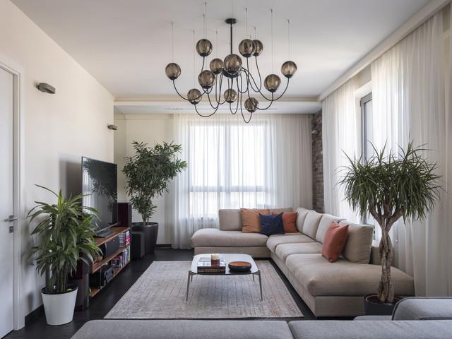 Гостиная с двумя окнами (80 фото): дизайн интерьера зала площадью 25 кв. м с акцентом на одной стене, оформление разных стен в большой комнате