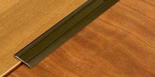 Стык плитки и ламината с порогом и без него – практический гид и 40 фото
