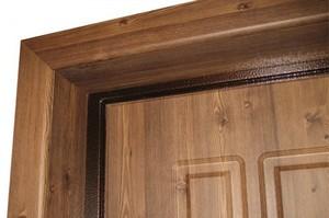 Выполнение отделки входной двери: различные виды материалов