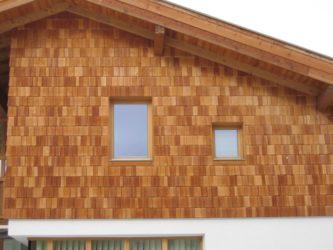 Фасад дома из гибкой черепицы: правила обшивки