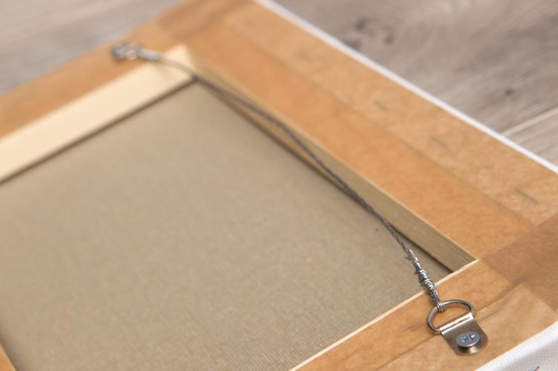 Как повесить картину на стену без сверления: правила, виды крепежей, инструкция