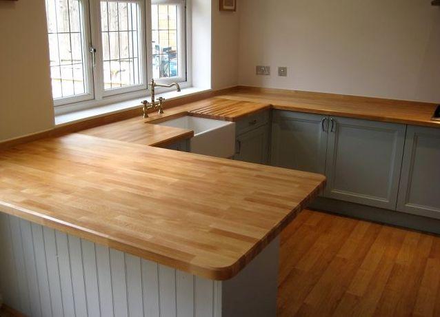 Угловая столешница для кухни: без стыков, материалы, выбор и монтаж, советы, фото.