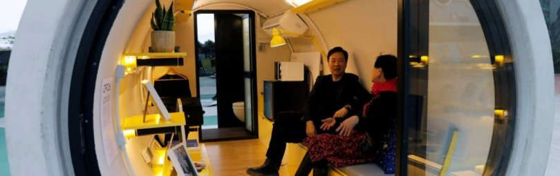 "Architect James Law sits inside of his work, ""Opod"", a 120-square-ft giant water pipes, designed as micro-housing in Hong Kong, China December 14, 2017. Picture taken on December 14, 2017. REUTERS/Tyrone Siu"