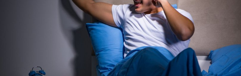 Young man struggling from noise in bed