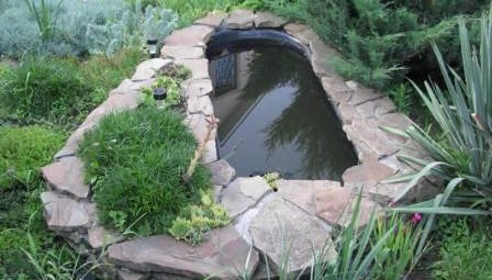 пруд из чугунной ванны